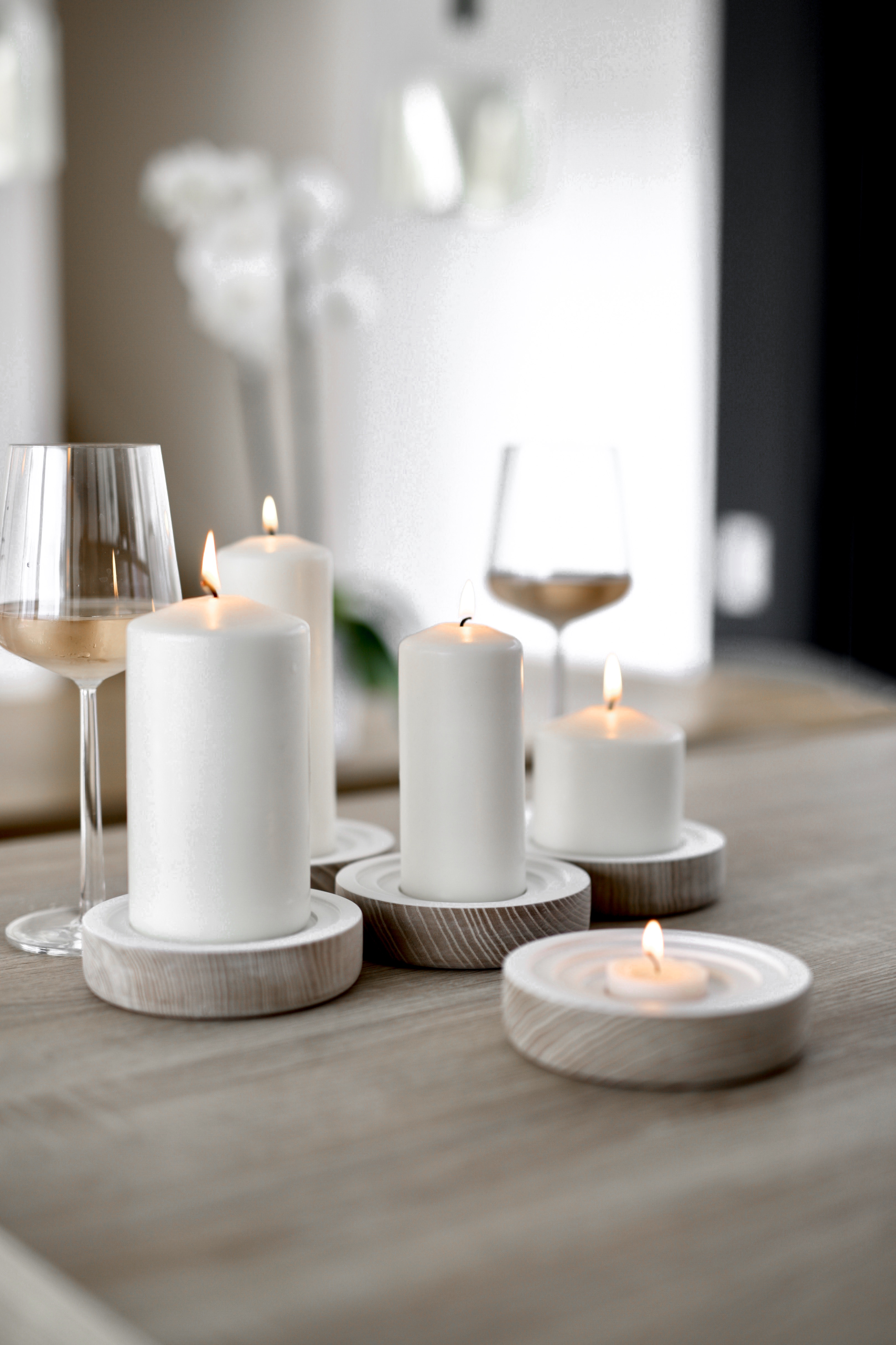 Image of a bright room with wine glasses and candles, depicting an environment very appealing to one's sense of smell
