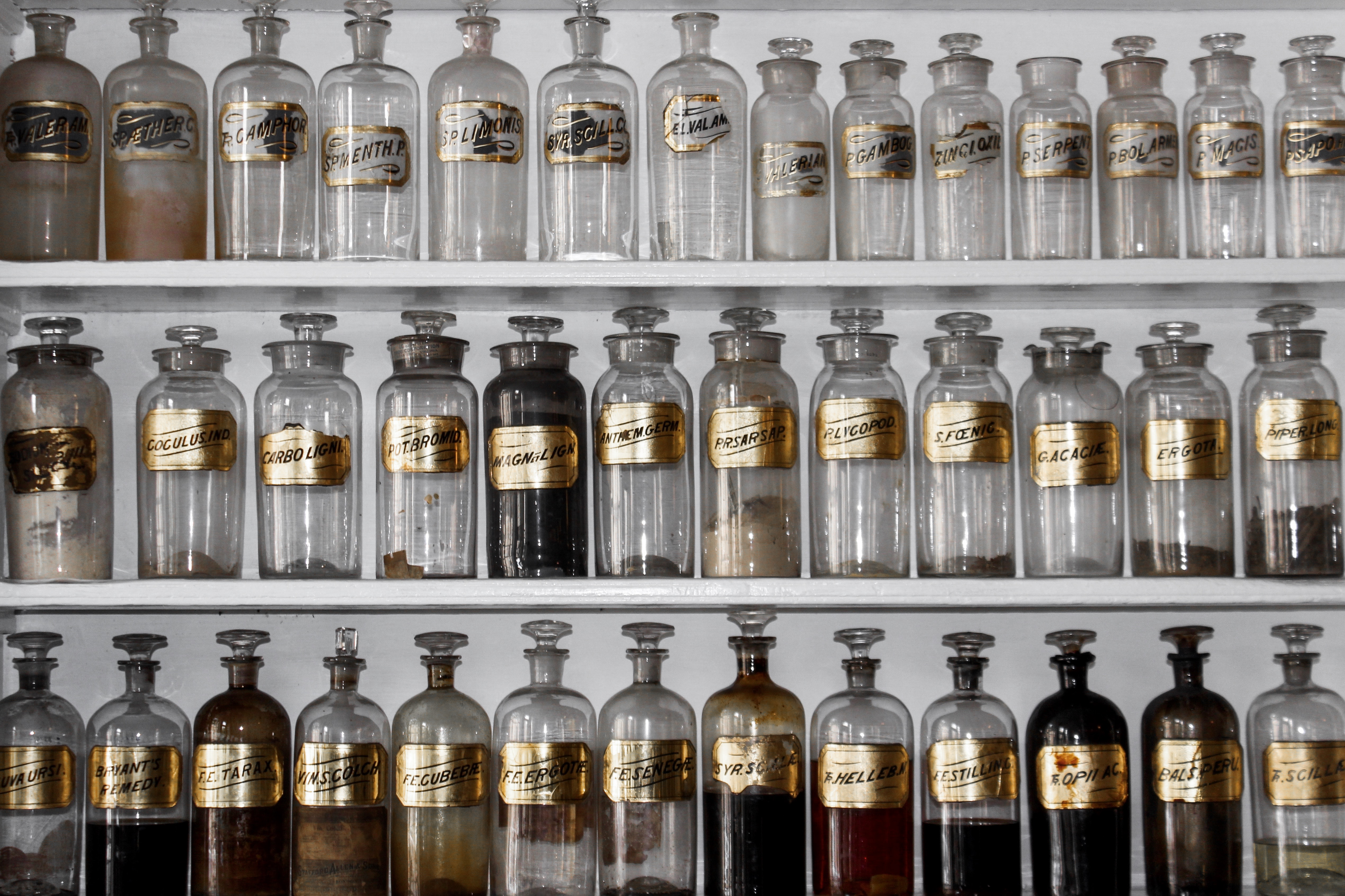 Shelves with bottles of fragrance ingredients in an apothecary