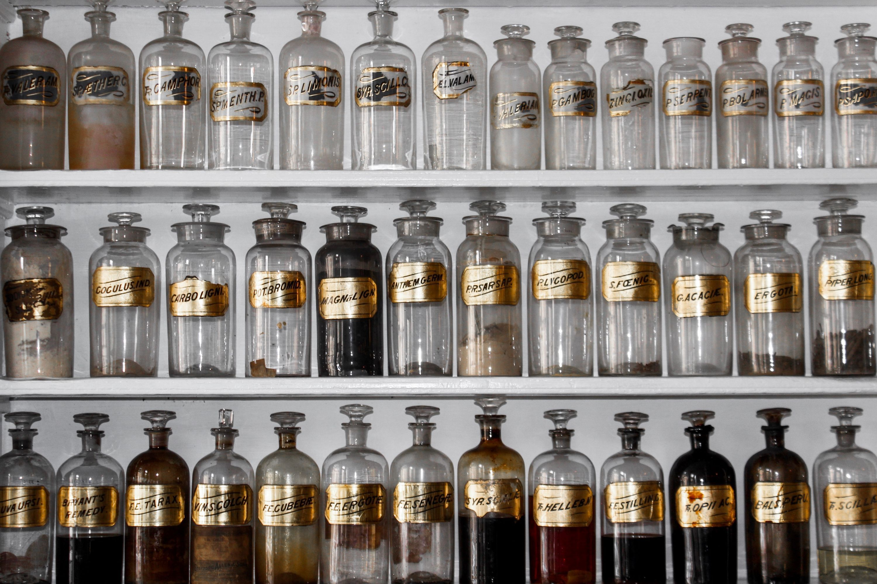 Shelves with bottles of fragrance ingredients in an apothecary  Photo by Matt Briney on Unsplash