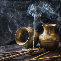 smoky photo of burning incense and gold, decadent spice jars