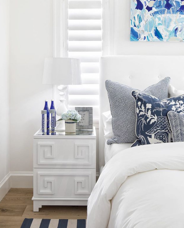 White and classic blue ocean color palette in a coastal beach house home decor bedroom
