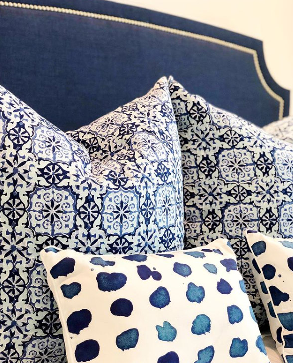 throw pillows with a coastal blue color palette and dark blue ocean colors