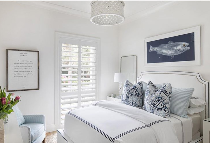White and blue color scheme bedroom with beach house interior design