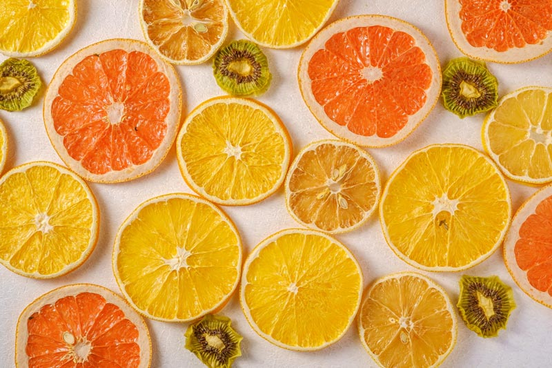 tropical home decor ideas and warm color trends with yellow and orange citrus fruit