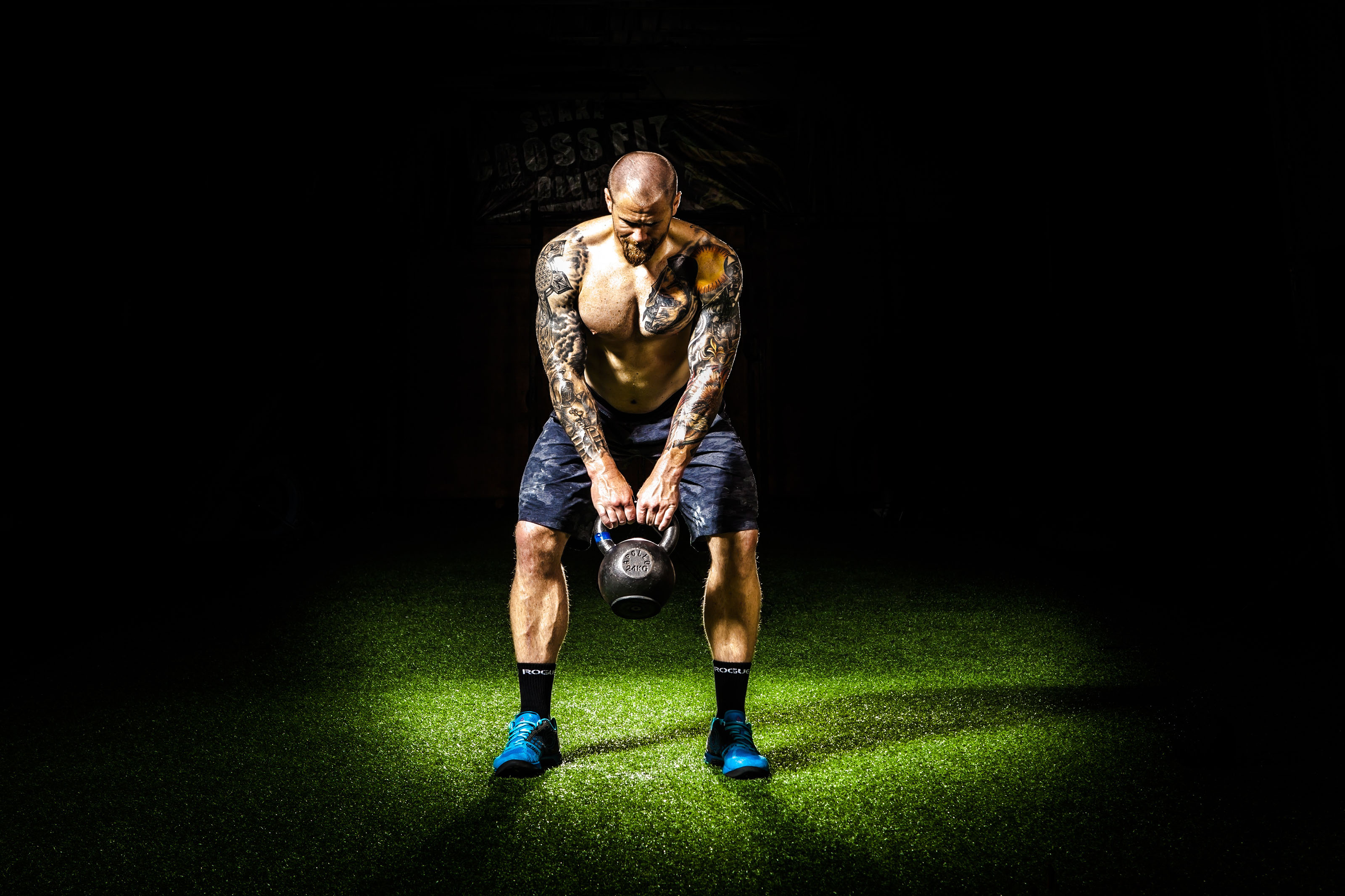 Fit Man Exercising with Kettle Bell