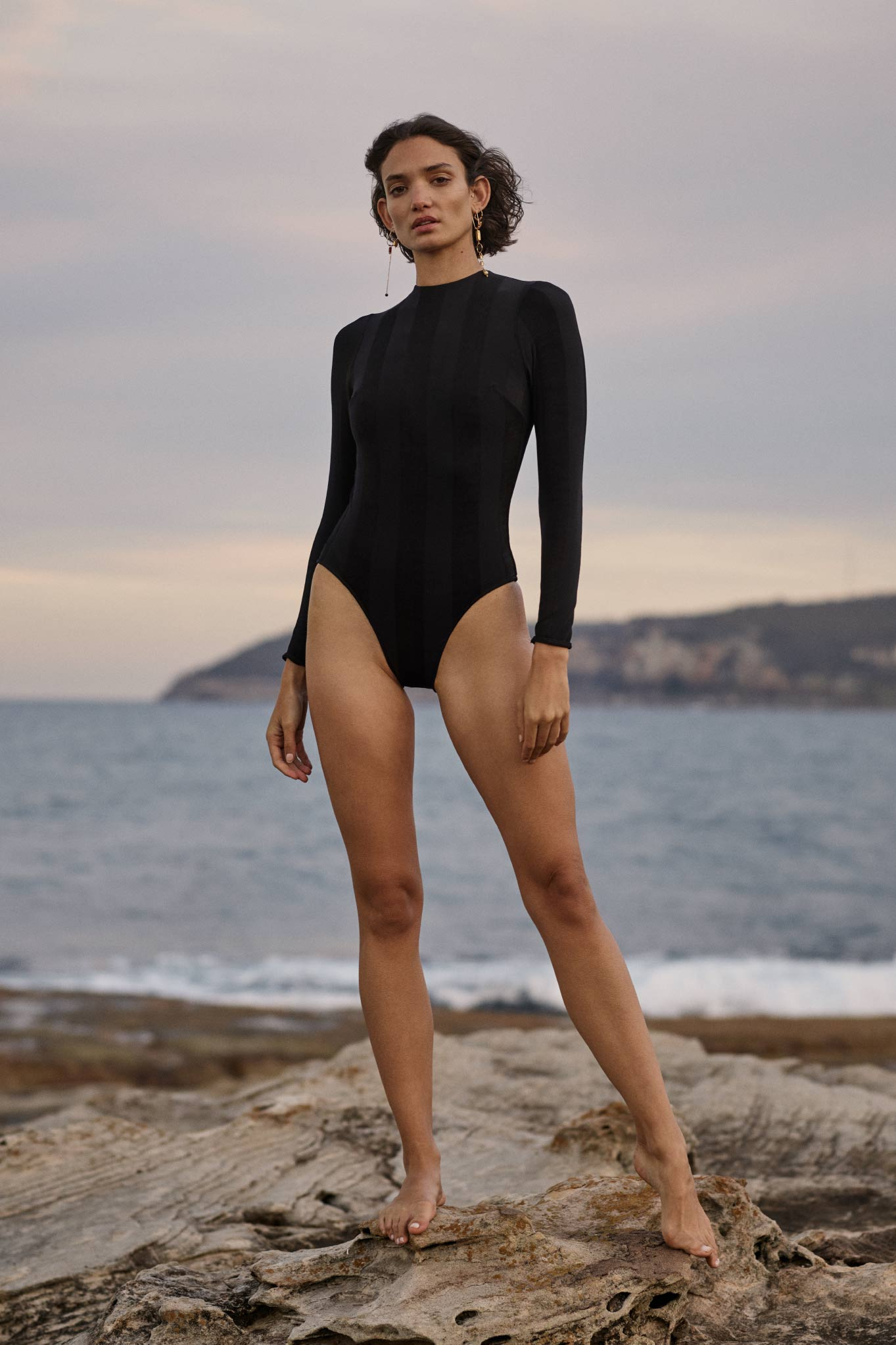 BONDI BORN's designer swimwear creates eternally chic rashguards that cover with style.