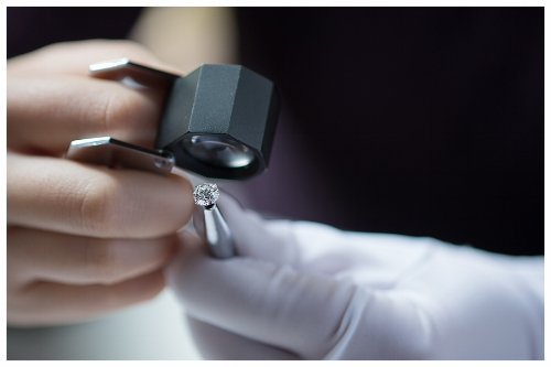 Jeweler Inspecting a Handcrafted Engagement Ring with a Loupe