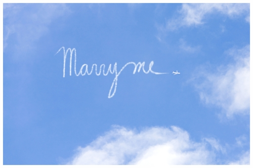 Skywriter Writing Marry Me in the Blue Sky