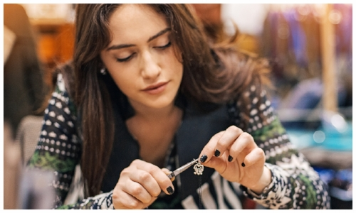 Female Jewelry Designer Manufacturing a Piece
