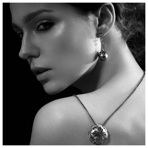 Fashion Model Wearing Gold Pendants
