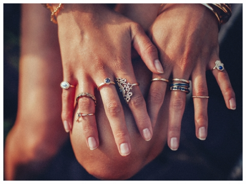 Woman wearing different gold rings