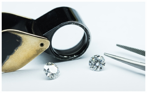 Jewelry Loupe with 1 Carat Diamonds Used to Determine the Gem's Authenticity