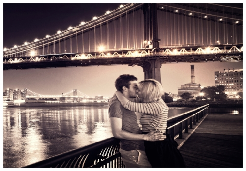 Young Couple Kissing by a Bridge
