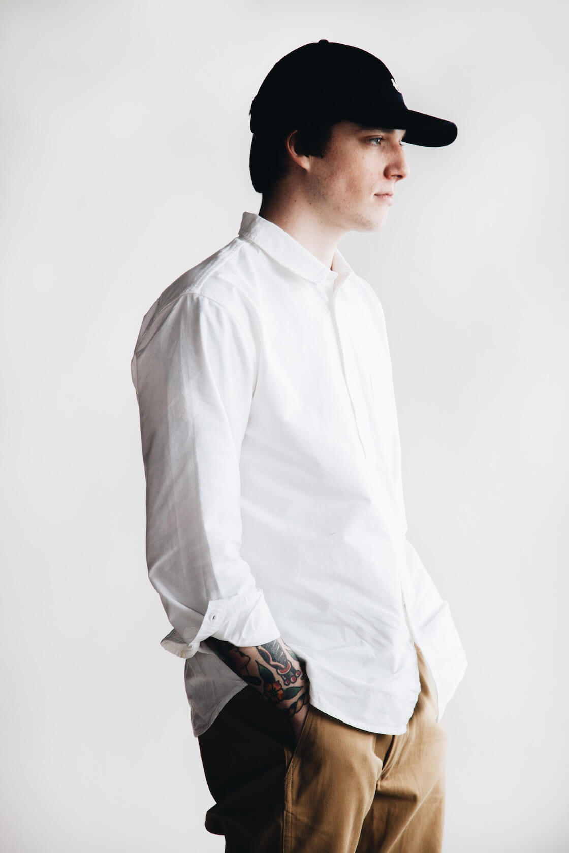 canoe club x corridor white oxford shirt, nanamica chino cap, an orslow army trousers on body