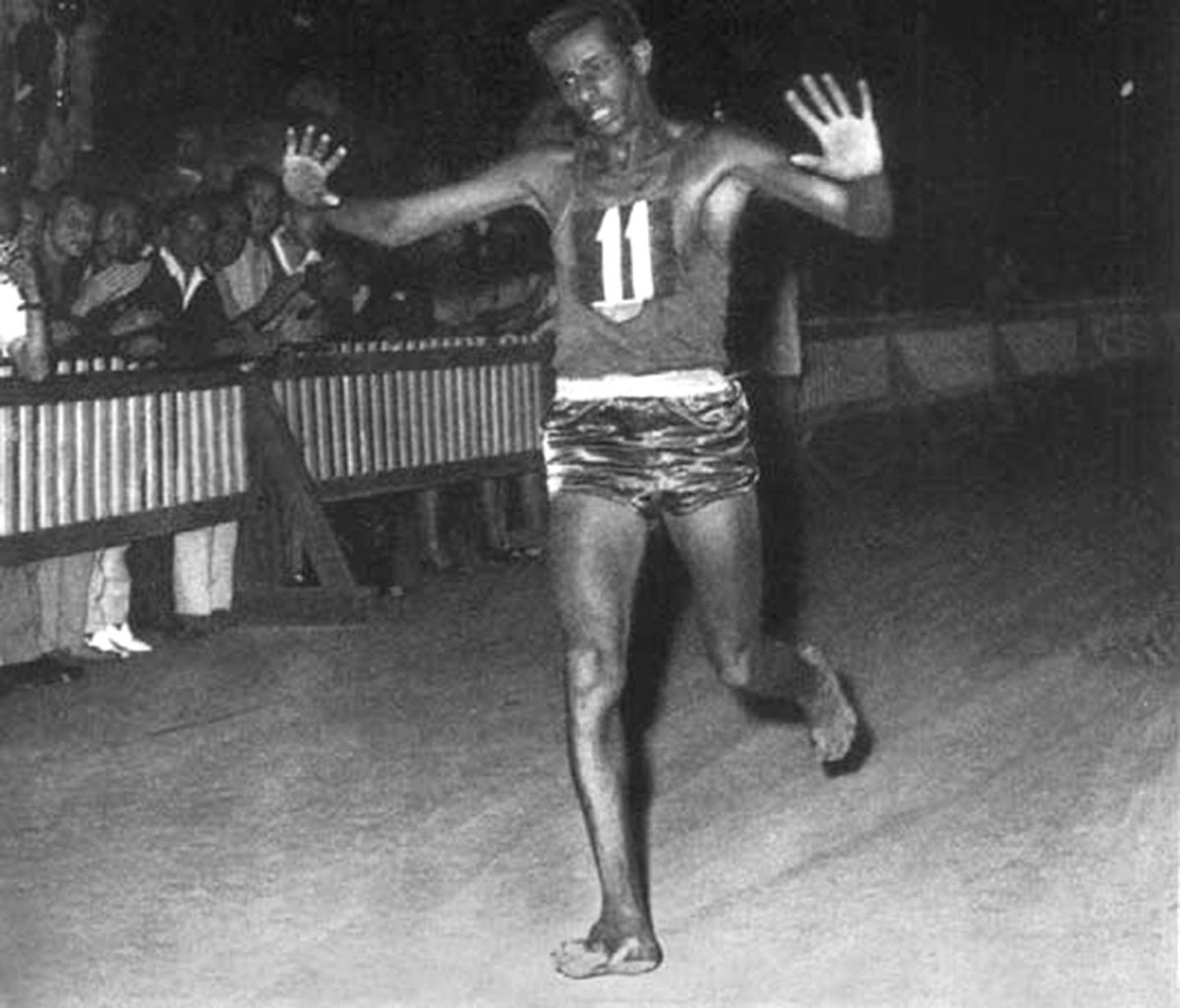 abebe bikila running barefoot in the 1956 olympics
