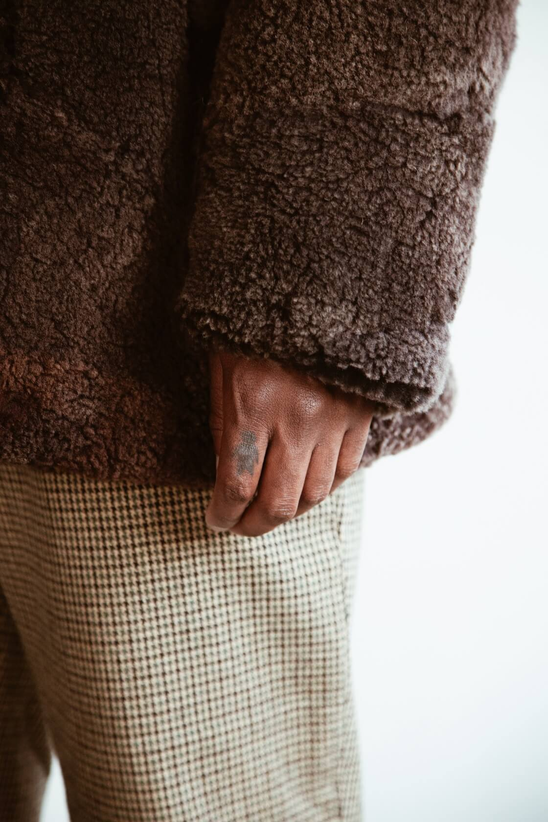 Patchwork Mouton Coat from Sugar Cane, Polo Neck Sweater from Mountain Research, and Andover Pant from Engineered Garments