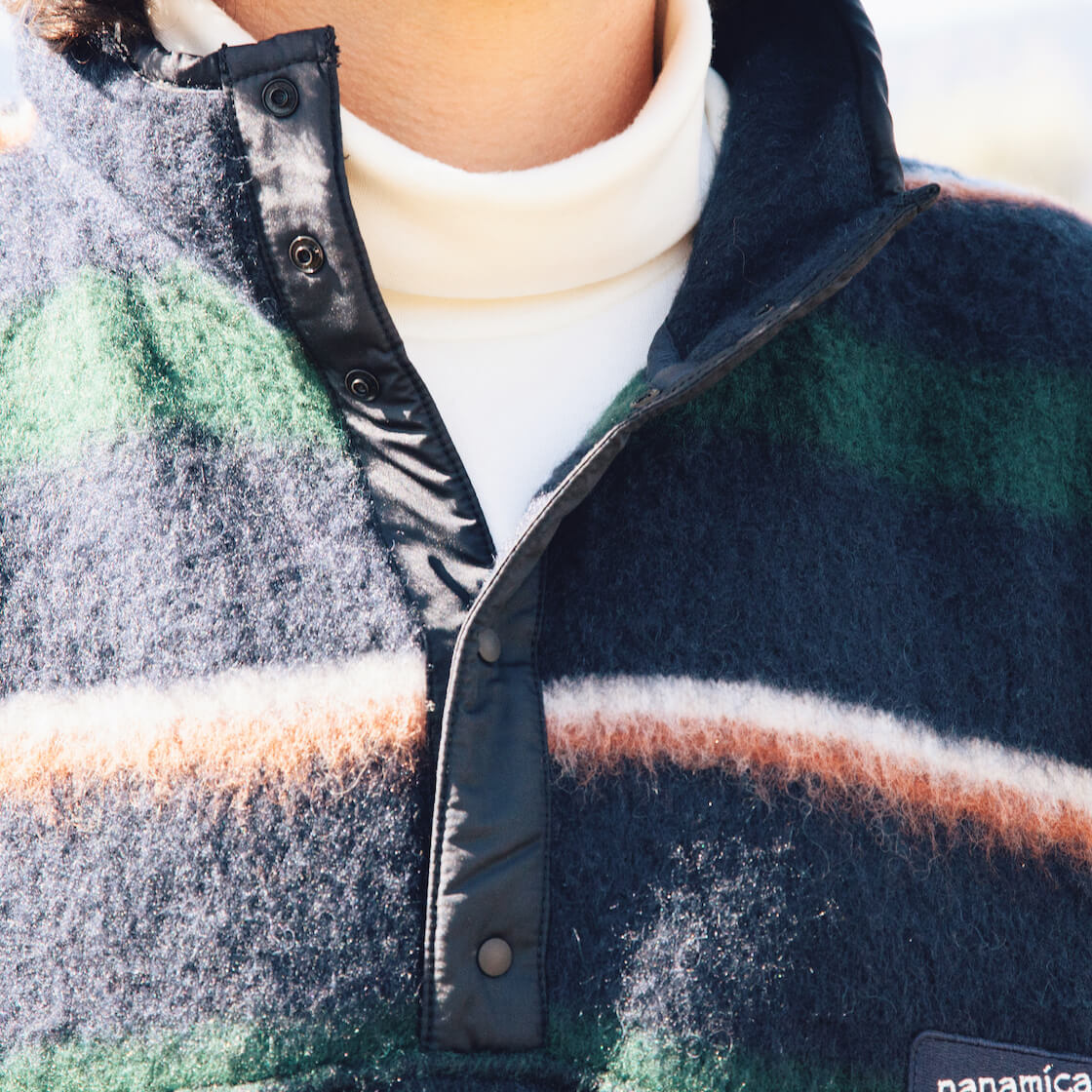 nanamica pullover sweater and nanamica white turtleneck on body