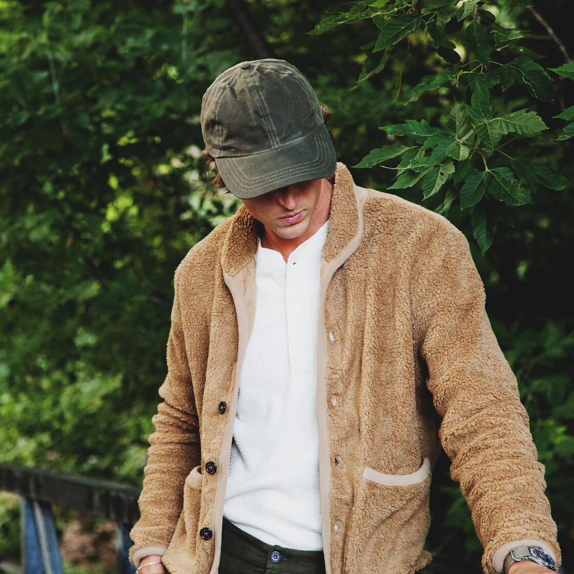 Universal Works lancaster jacket and corridor nyc waxed cap on body