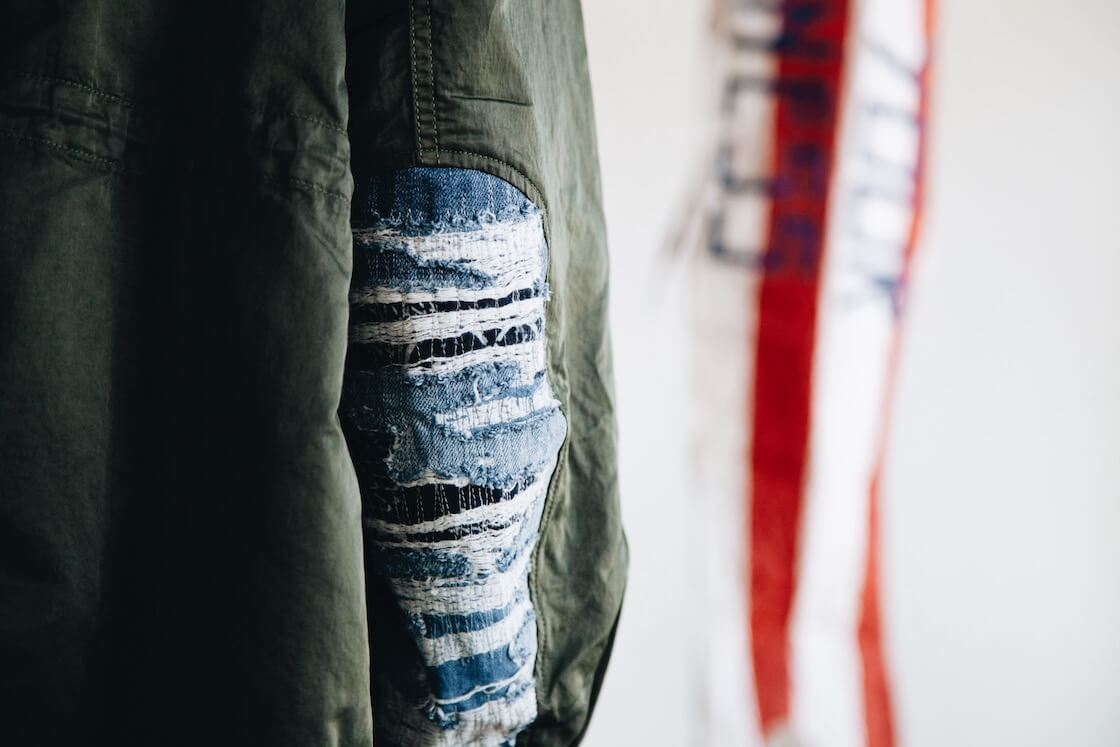 visvim indigo camping trading post find your happiness six five fishtail parka on body