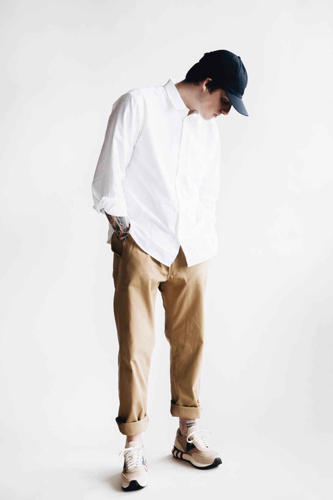 canoe club x corridor white oxford shirt, nanamica chino cap, orslow army trousers and visvim attica trainers on body