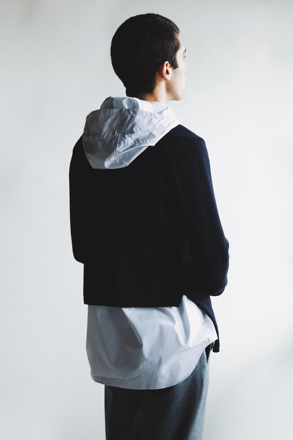 Comme des garcons shirt fully fashioned knit gauge 10 wool sweater and yarn dyed cotton poplin hood shirt, beams plus ivy flannel trousers on body