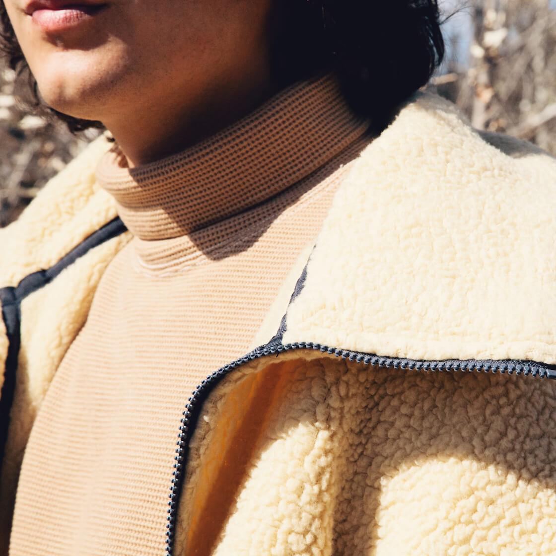 nanamica fleece jacket and turtle neck shirt on body