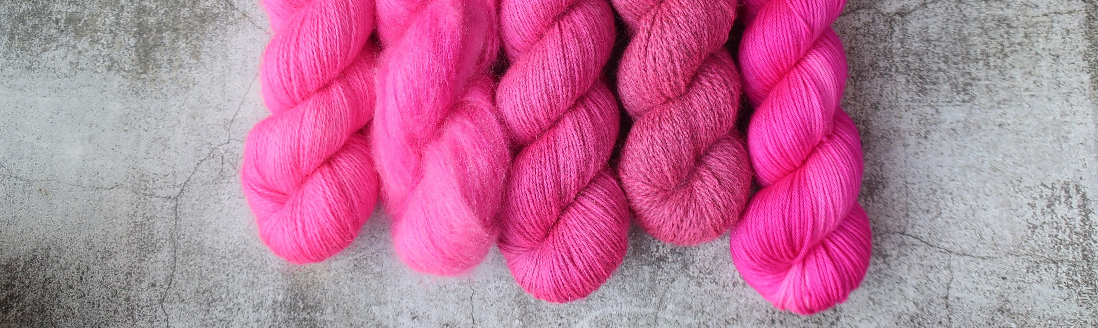 Five yarn bases in the neon pink colourway Rebelling Against Suburbia by Countess Ablaze