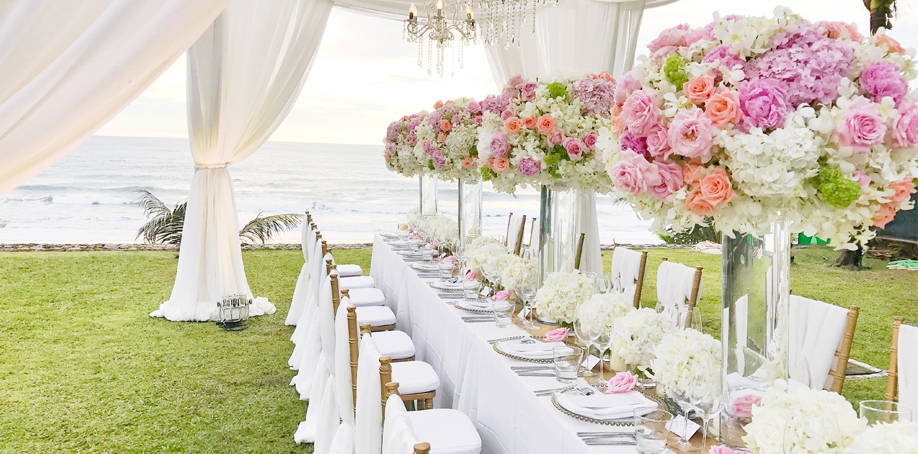 Outdoor spring/summer wedding reception featuring white, pink, green chiffon and polyester linens