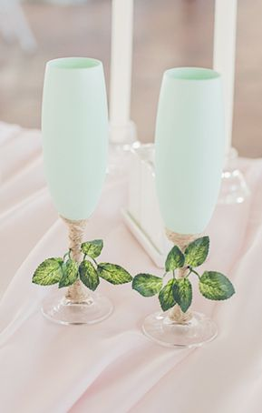 Seafoam green cocktail and champagne glasses with greenery