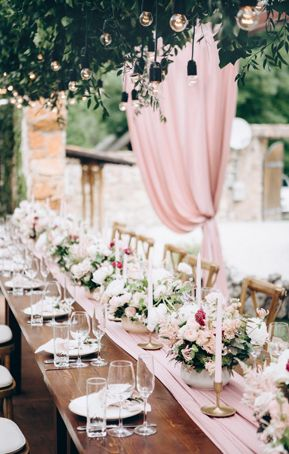 Rustic dusty rose outdoor wedding reception with place settings and chiffon table runner