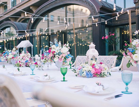 Emerald green, white, fuchsia, and dusty blue spring wedding outdoor reception table
