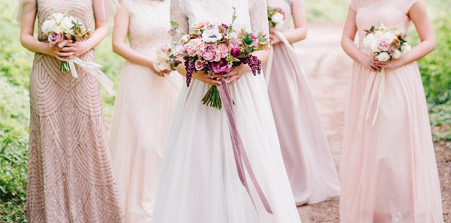 Dusty rose/mauve bridal party with sage and emerald green bouquets