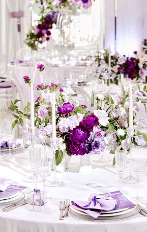 Victorian lilac, lavender, sage green, white indoor spring wedding reception table setting