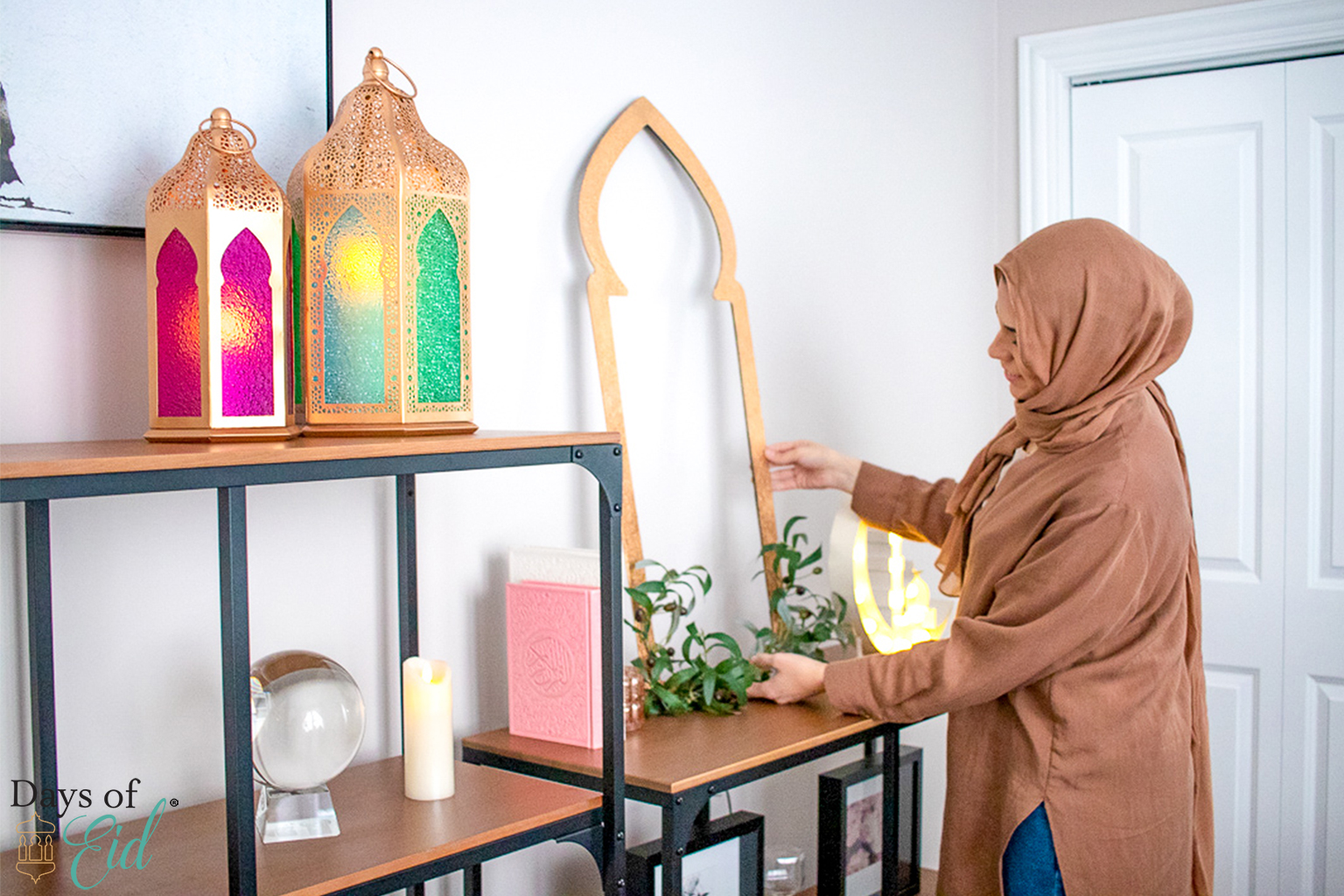 Founder Reem sets up lanterns and door decor inside her home