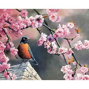 Vogel im Blütenbaum