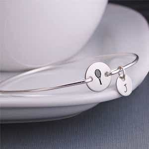 Silver bracelet with tennis ball and initial