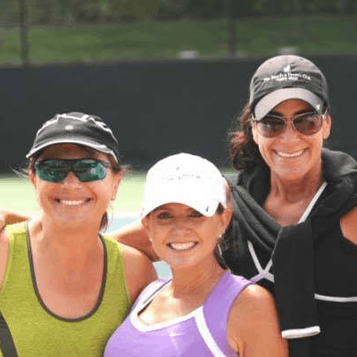 Three happy ladies who just finished playing tennis