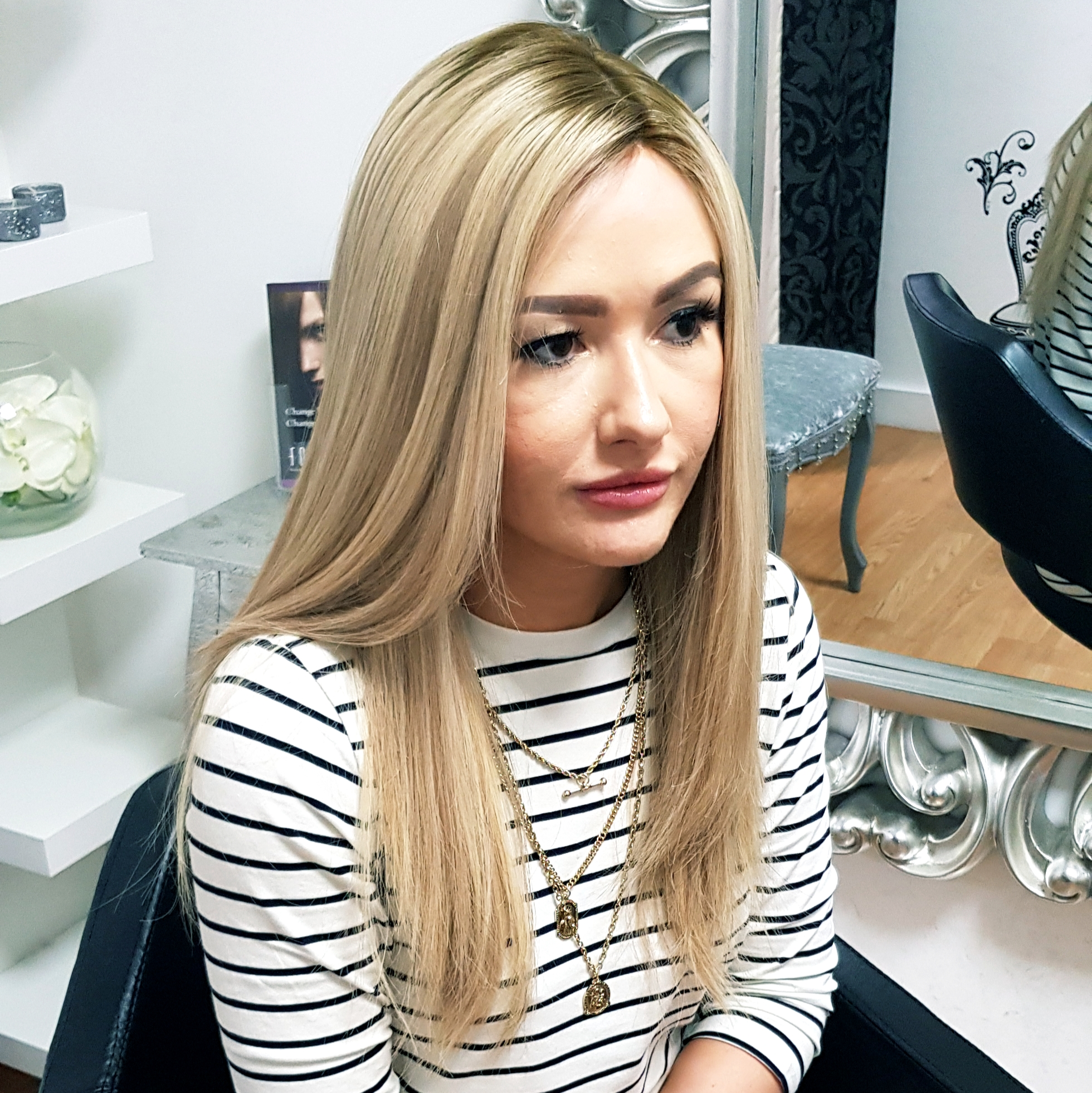 "aspire hair customer wearing the 16"" iWig in colour 22/9 rooted blonde, classic collection select human hair."