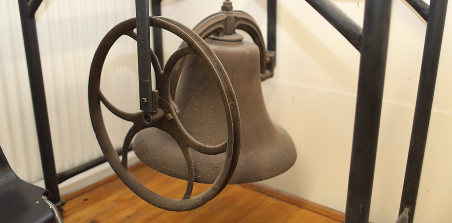 The original bell used in the early 20th century to signal shift change