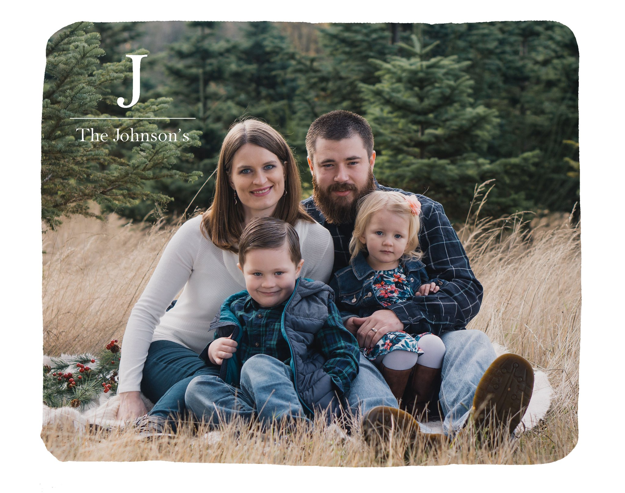 Custom photo blanket featuring married couple and two children in a landscape setting