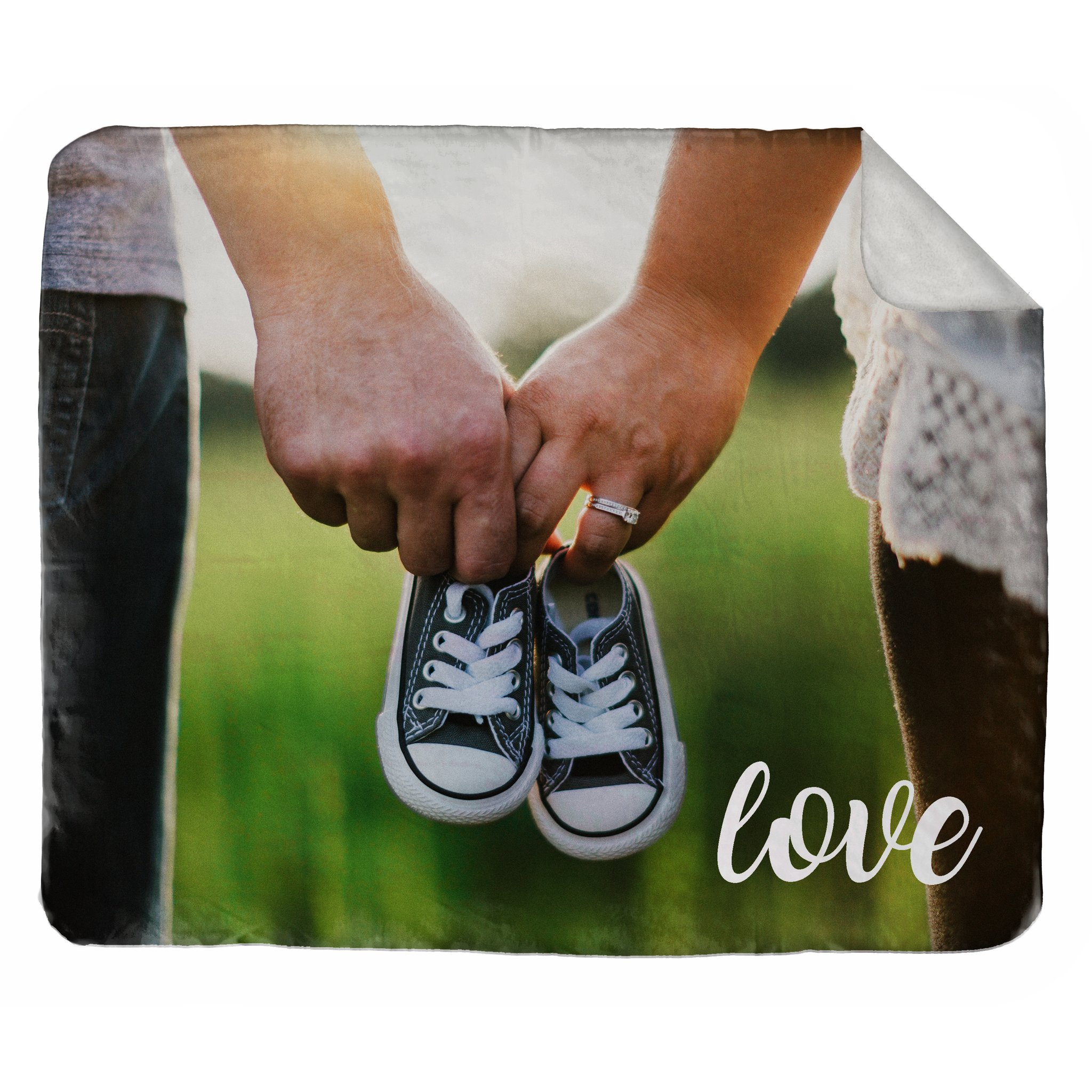 Personalized photo blanket featuring couple holding hands and baby shoes