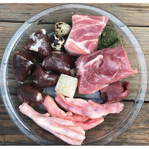 Raw turkey hearts meal for your Frenchie idea #37  Turkey hearts, pork shoulder boneless, duck feet, beef kidney, quail eggs, bone broth cube, and VitaBoost supplement.
