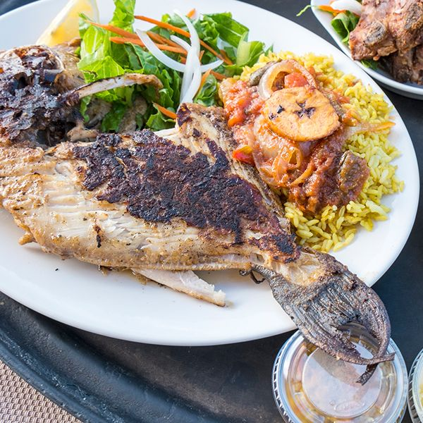 High Quality Organics Express Cajun black fish and rice with salad