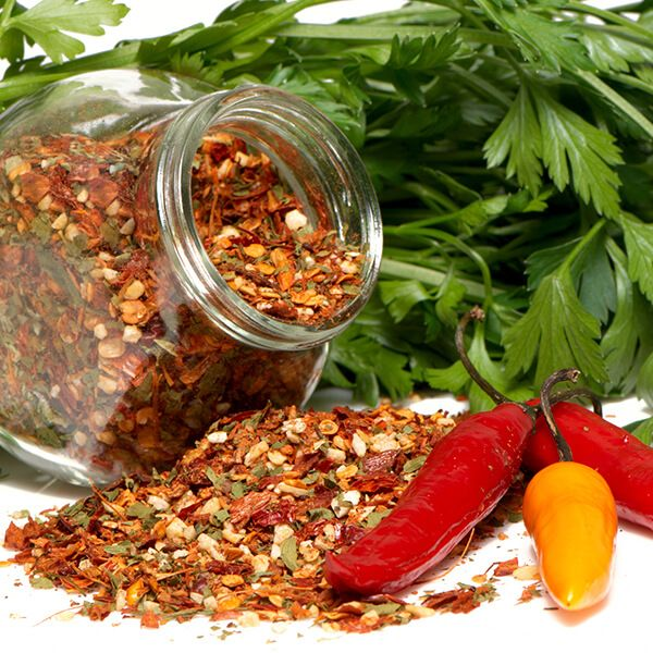 High Quality Organics Express cajun spice in a jar with fresh peppers