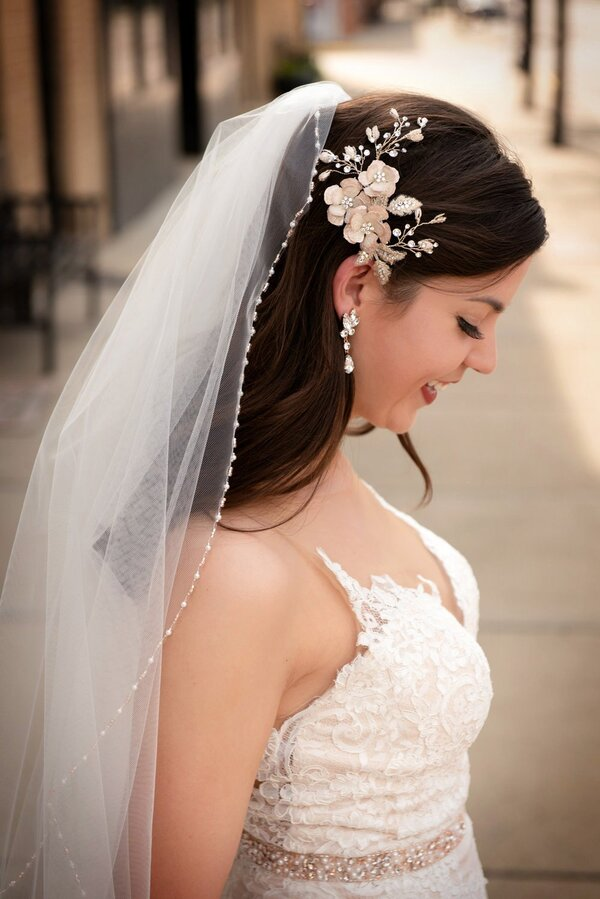 bride wearing wedding veil with embellished details