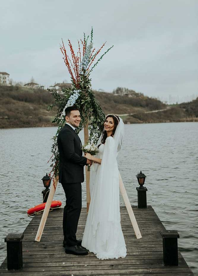bride and groom getting married on the lake