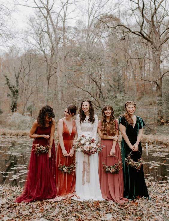 bride and bridesmaids in autumn wedding
