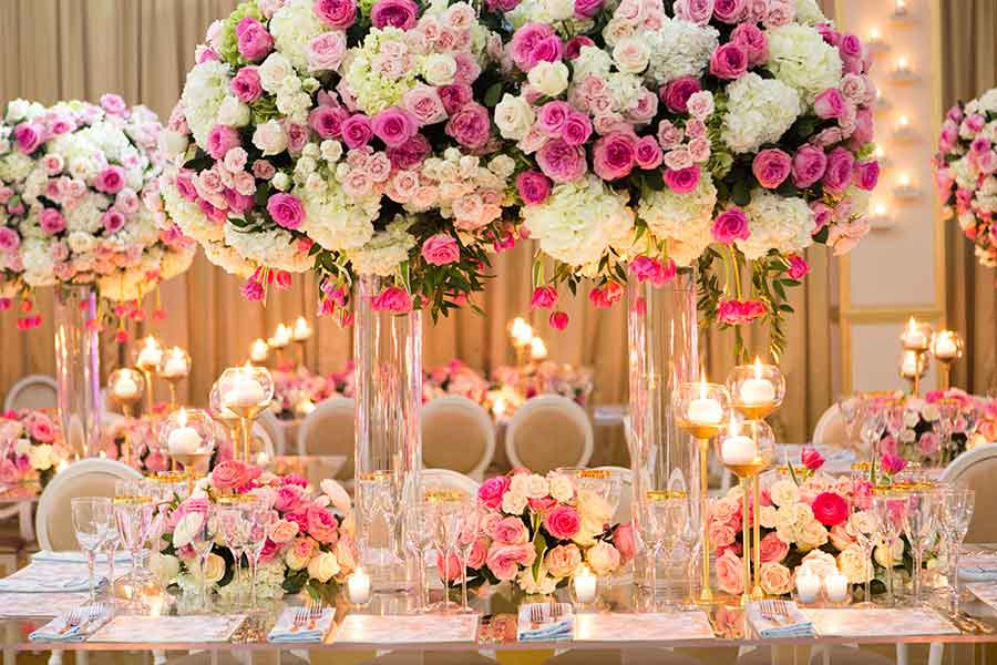 glamorous wedding decor with floral table centerpieces