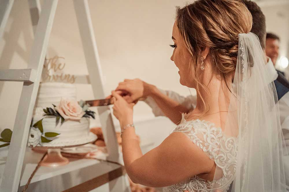 Bride Cutting Wedding Cake
