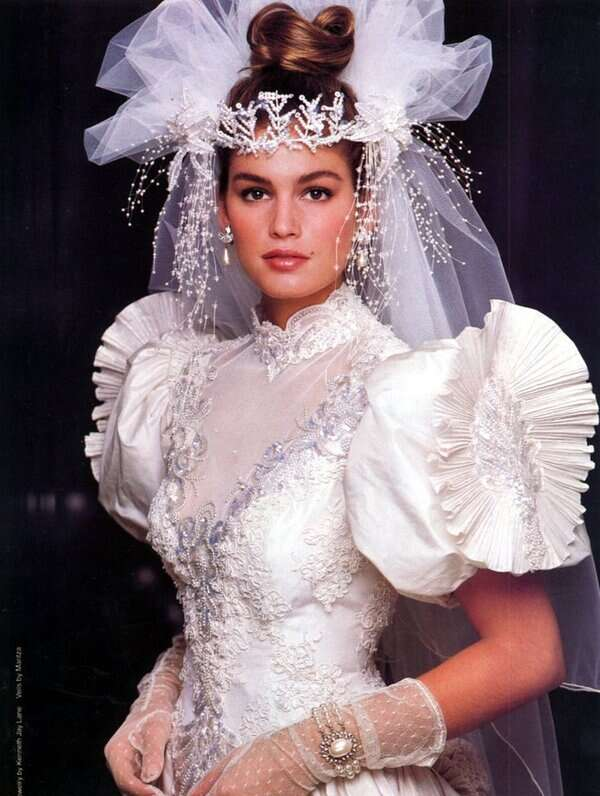 bride wearing elaborate veil from the 1980s